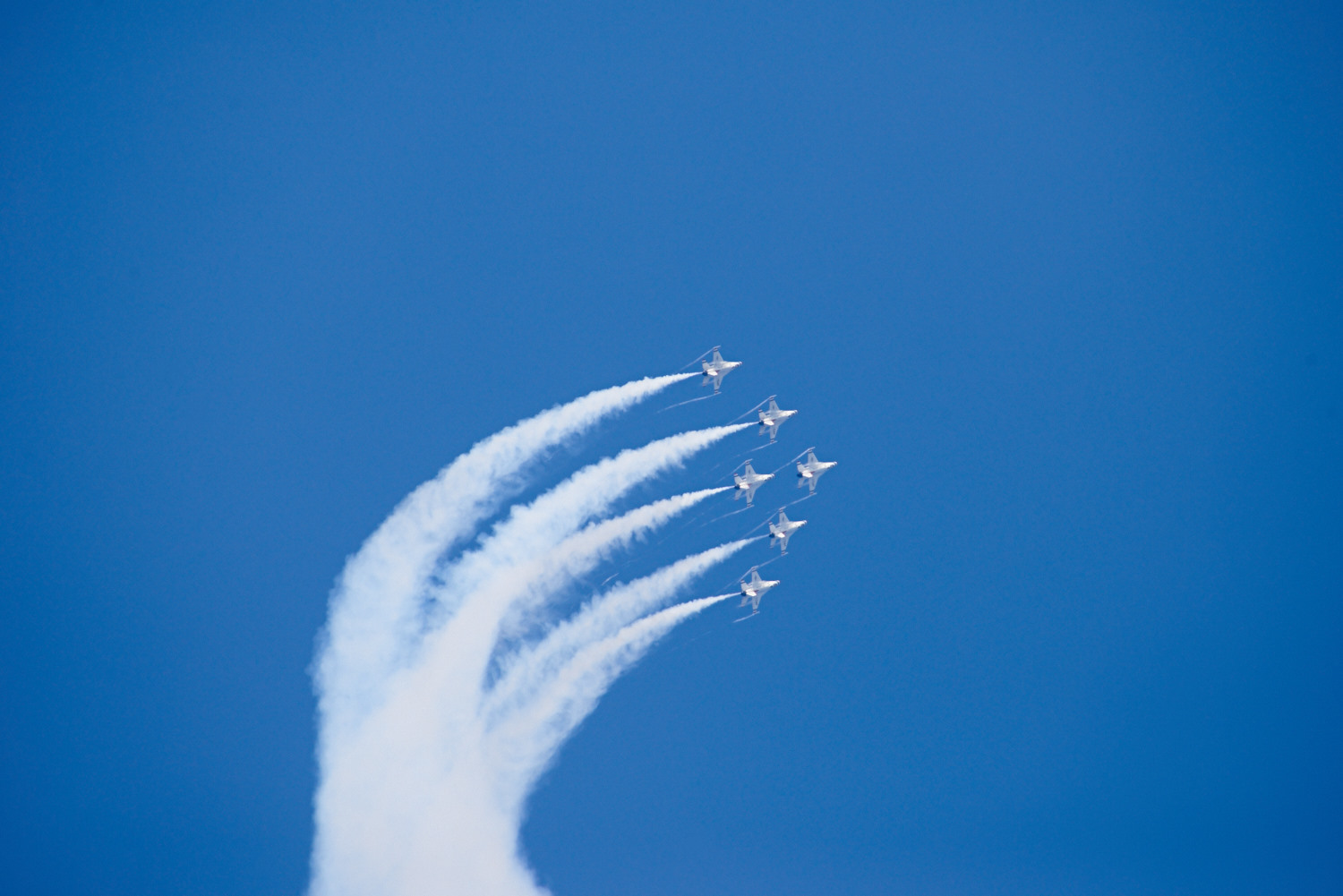 All the Thunderbirds flying in a Delta Formation