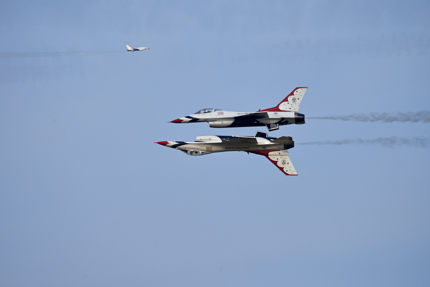Thunderbirds solo planes perform a Reflection Pass